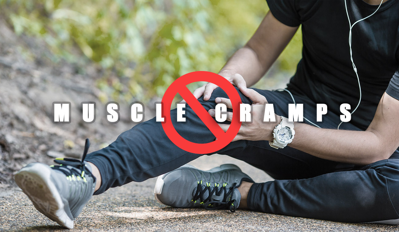 Male athlete suffering from pain in leg because of muscle cramps while exercising outdoor